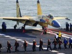 Chineese navy  successfully lands its fighter jet on the first aircraft carrier