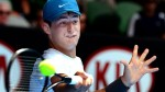 Experienced federer handles tomic
