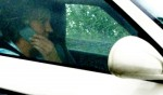 Captain Slow caught on Cell phone while driving his Porsche 911